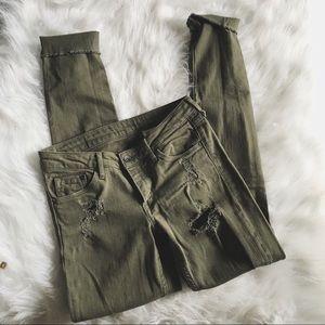 Skinny distressed olive jeans
